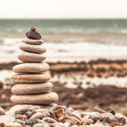Featured Image for Abraham maslow's Hierarchy of Needs - Pile of stone placed on top of other in a hierarchy
